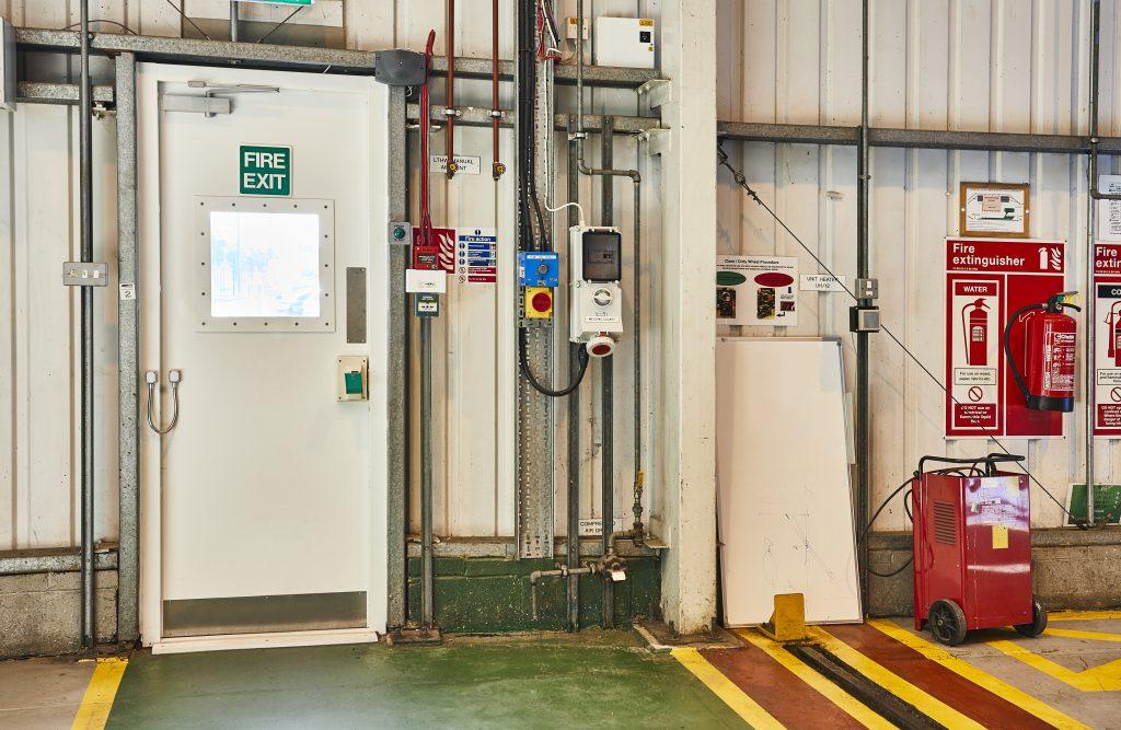 Croydon Tramline Depot fire exit door with vision panel.